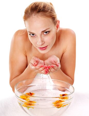 Facial massage with herbal facial treatment. Isolated. photo