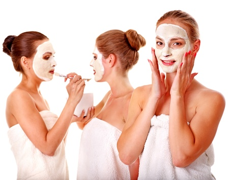 Young woman getting facial mask and gossip . Isolated. Stock Photo - 14742087
