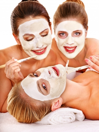 Group woman getting facial mask and gossip . Isolated. Stock Photo - 14741995