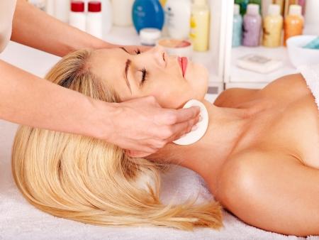 Blond beautiful woman getting head massage. photo