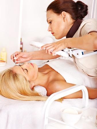 Woman getting tweezing eyebrow. Stock Photo - 14743232