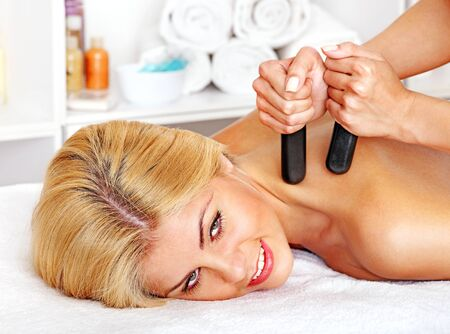Satisfied woman getting massage in health resort. Stock Photo