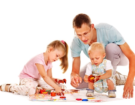 Happy family with child painting by finger paint. photo