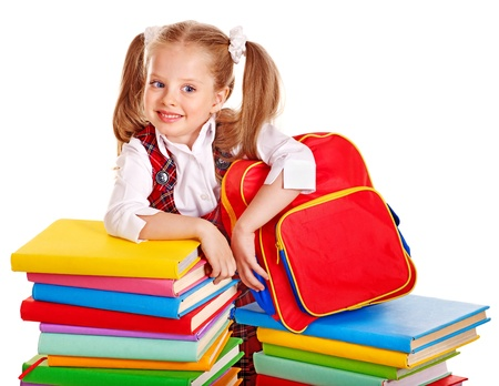 Child with backpack holding book. Isolated. photo