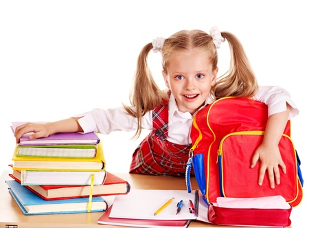 school supplies: Happy little girl with school supplies and book. Isolated.