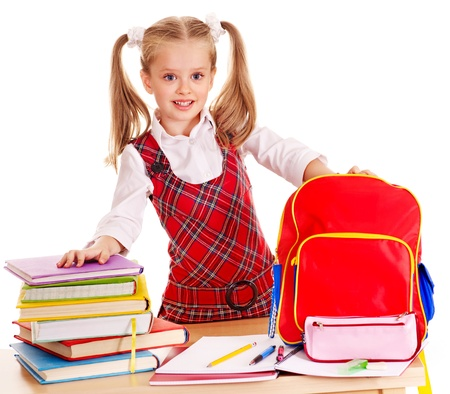 Child with school supplies and book. Isolated. photo