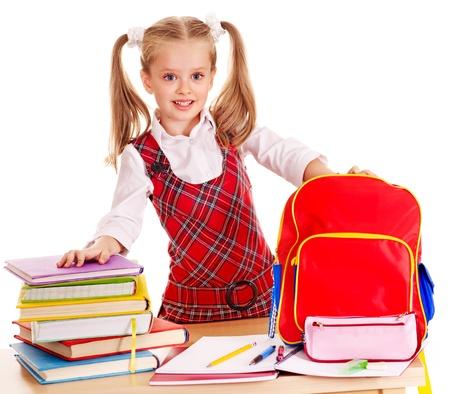 colegiala: Niño con útiles escolares y libros. Aislado. Foto de archivo