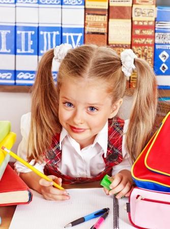 schoolchild: Child  writing in classroom. Stock Photo