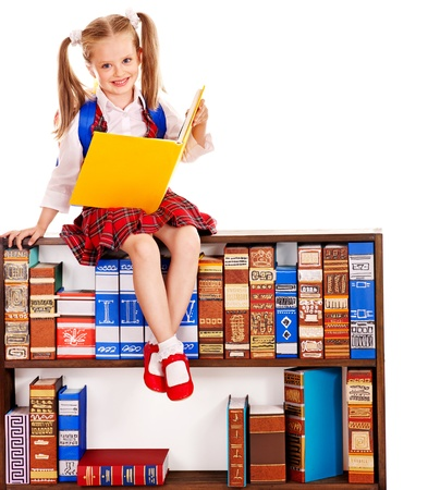 Happy child holding book with bookshelf. photo