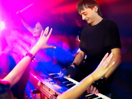 Musical group performance in night club. Lighting effects. Stock Photo - 14741281