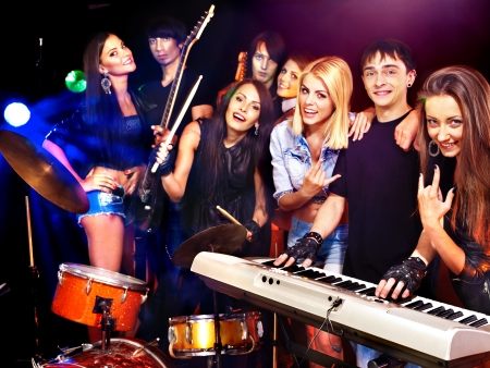 lighting effects musician: Musical group male and female  performance in night club.