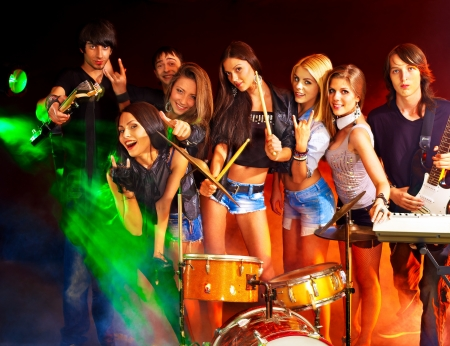 Musical group performance in night club. Lighting effects. photo