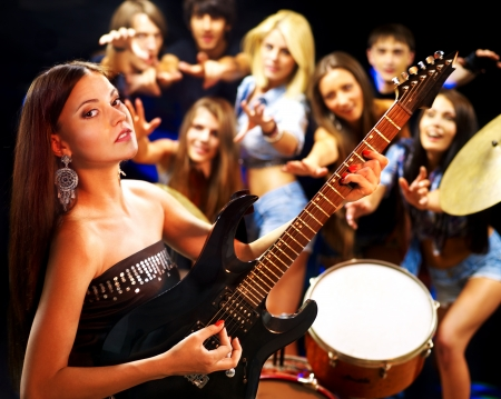 Musical group playing in night club. Male and female. Stock Photo - 14741849