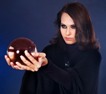prophecy: Young beautiful woman with crystal ball. Stock Photo
