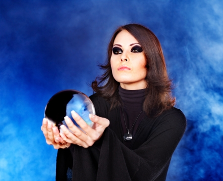 Woman holding crystal ball. Fortune telling. photo