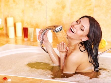 woman bathrobe: Young woman bathing in bathroom.