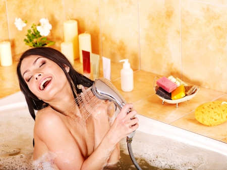 sud: Young woman take bubble  bath.