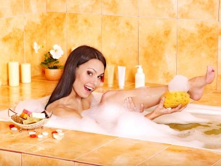 Young woman take water bath. photo
