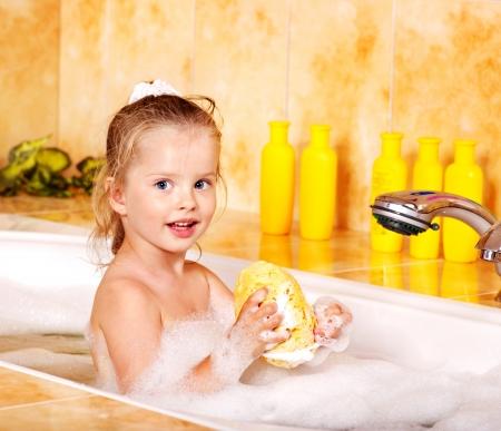 little girl bath: Little girl washing in bubble bath .