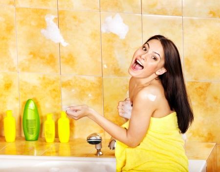 wisp: Young woman take bubble  bath.