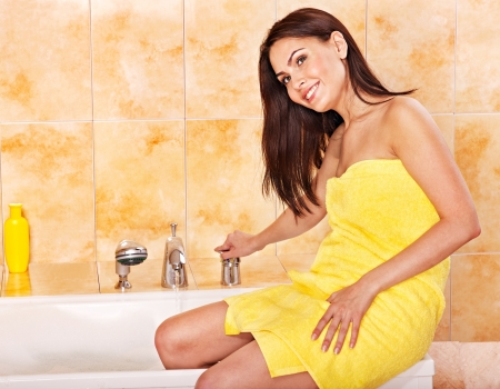 Woman wearing towel  take bubble  bath. photo