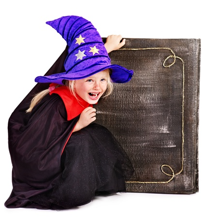 Witch little girl holding  book. Halloween. Stock Photo - 15231759