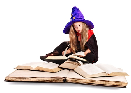 Witch little girl holding  big old book. Stock Photo - 15231467