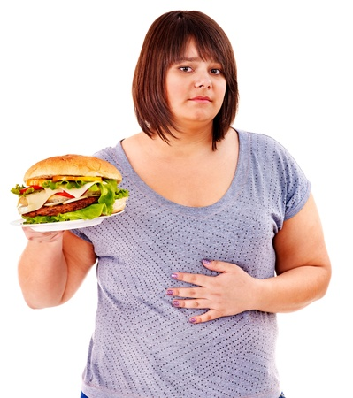 stomachache woman: Woman get abdomen pain after eating fatty food. Isolated. Stock Photo