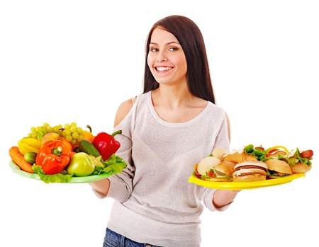 Woman choosing between healthy and unhealthy eating. Stock Photo - 15232219