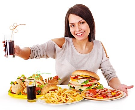 Woman eating fast food. Isolated. photo