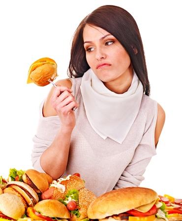 unhealthy living: Woman holding hamburger. Isolated. Stock Photo