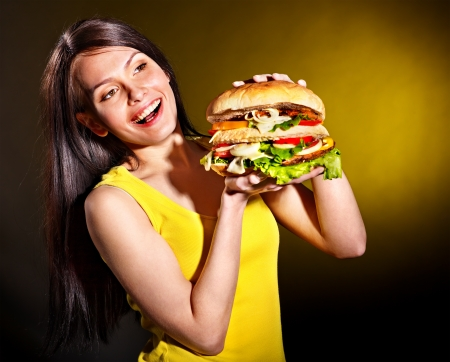 Slim woman holding hamburger. photo