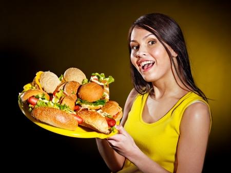 Slim woman holding hamburger. Stock Photo - 15231761