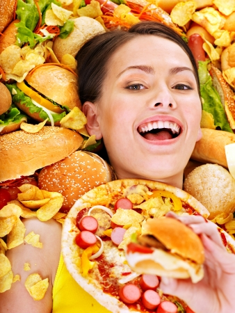 Thin woman holding hamburger. Stock Photo - 15232712