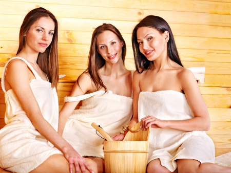 couple bathroom: Group female people relaxing in sauna. Stock Photo