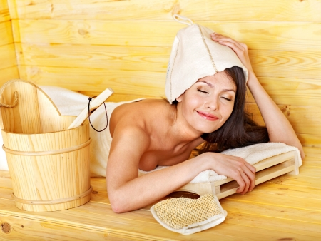 sauna: Young woman in hat relax sauna. Weight loss.