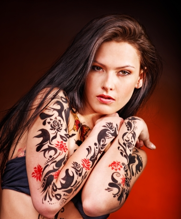 female sexy chains: Young beautiful woman with body art . Stock Photo