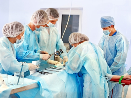 operation lamp: Group of surgeon at work in operating room.