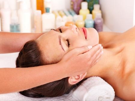 beauty therapist: Beautiful woman getting head massage. Stock Photo
