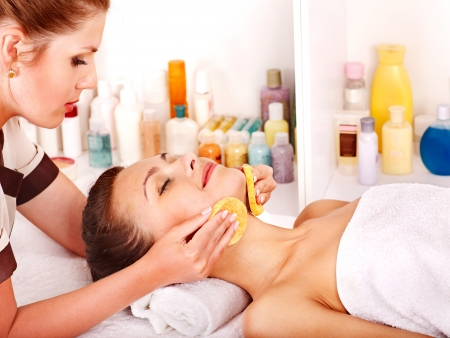 beauty parlour: Young woman getting facial  massage. Stock Photo