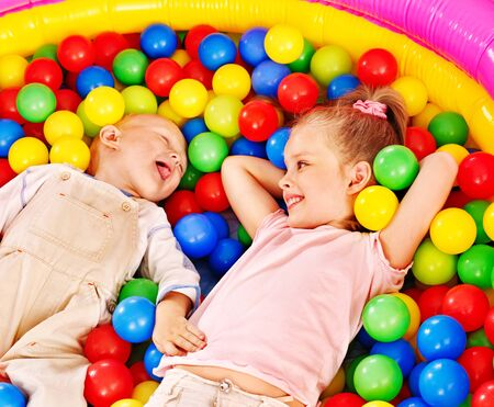 Children playing in colored ball. photo