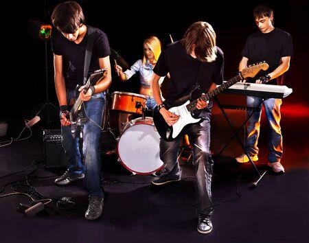 Group peole playing  guitar in night club. Stock Photo - 15231998