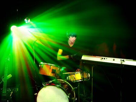 Man playing  guitar in night club. Lighting effects. Stock Photo