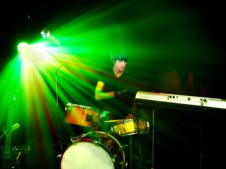 stage lighting: Man playing  guitar in night club. Lighting effects. Stock Photo