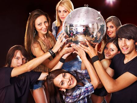 Woman on disco in night club. Disco ball. photo