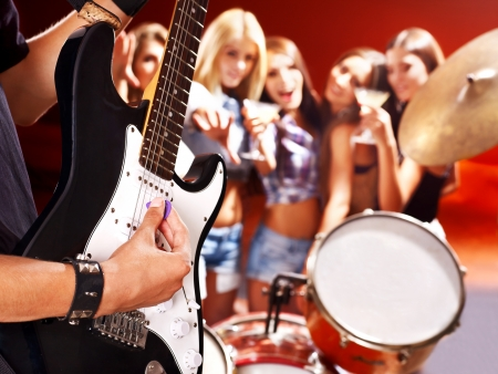 Woman beat guitar: Musical group playing in night club. Body part. Kho ảnh