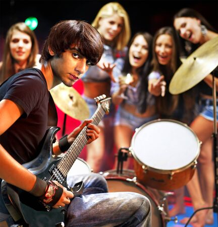 cymbals: Musical group playing in night club. Male and female. Stock Photo
