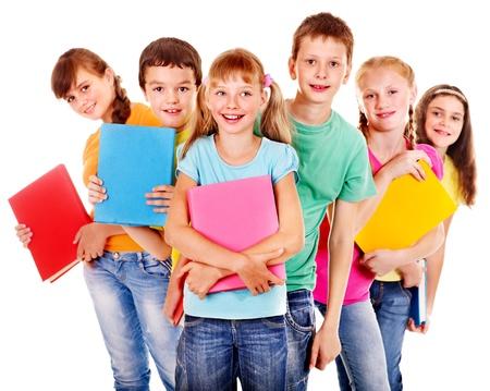 ni�o escuela: Grupo de ni�os felices escolar adolescente con el libro. Aislado.