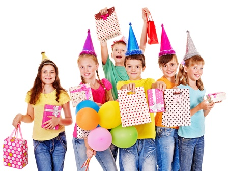 birthday celebration: Group of teen people in party hat. Isolated. Stock Photo