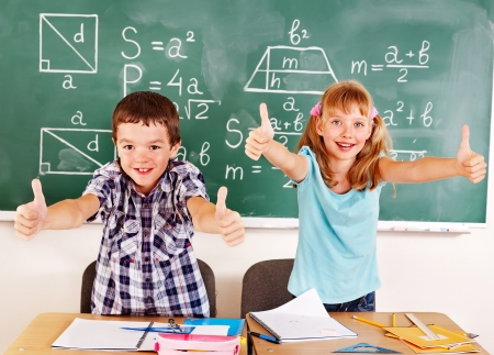 Group of school child sitting on desk in classroom. Stock Photo - 15231771